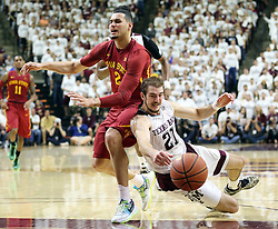 Texas A&M's Alex Caruso (21) fights for a loss ball against Iowa State's Abdel Nader (2) during the second half of an NCAA college basketball game, Saturday, Jan. 30, 2016, in College Station, Texas. Texas A&M won 72-62. (AP Photo/Sam Craft)