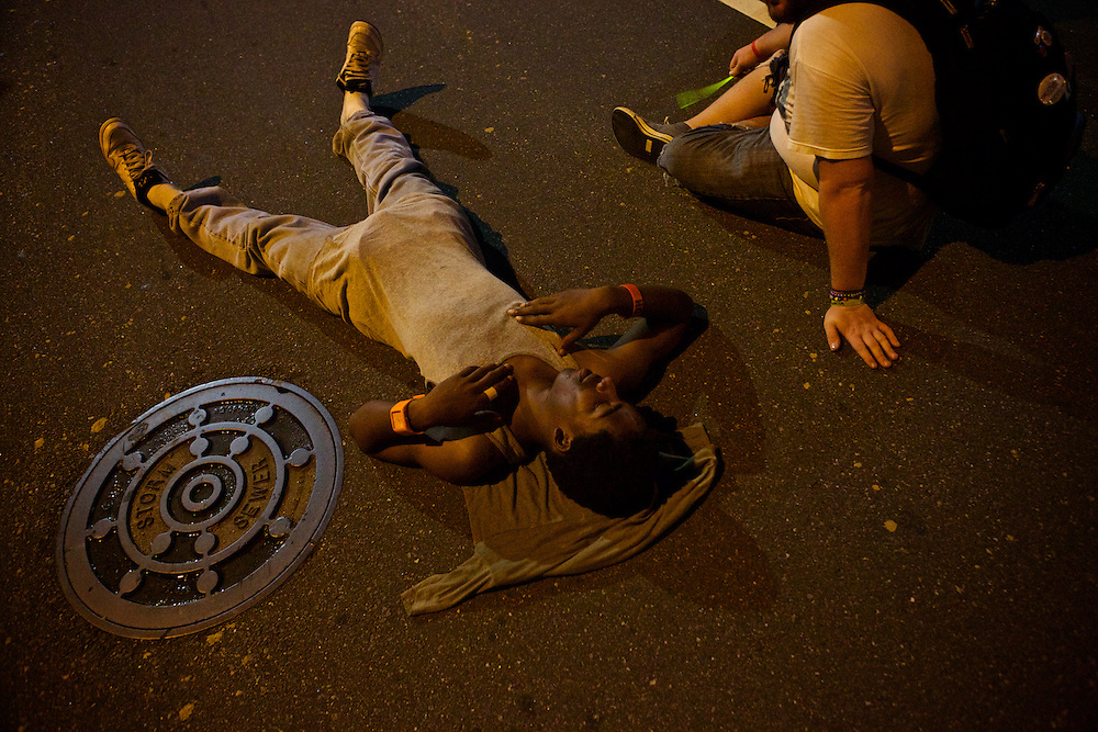 Protesters lay in the street during the 2012 Democratic National Convention on Thursday, September 6, 2012 in Charlotte, NC.