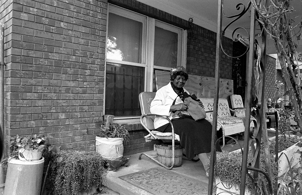 A woman sitting on her porch waiting to go to church. Memphis, USA