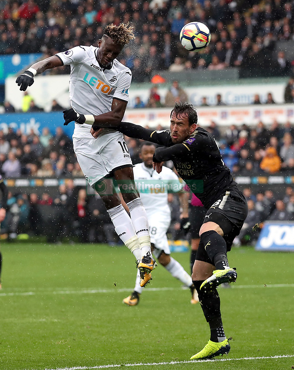 Swansea City's Tammy Abraham heads at goal during the Premier League match at the Liberty Stadium, Swansea.