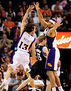 Apr. 11, 2011; Phoenix, AZ, USA; Minnesota Timberwolves guard Luke Ridnour (13) is guarded by the Phoenix Suns guard Steve Nash (13) and forward Jared Dudley (3) at the US Airways Center. The Suns defeated the Timberwolves 135 -127 in overtime. Mandatory Credit: Jennifer Stewart-US PRESSWIRE