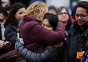 Protest organizer Stephanie Trask, left, embraces a fellow student during the March for our Lives protest in Madison, Wisconsin, Saturday, March 24, 2018.