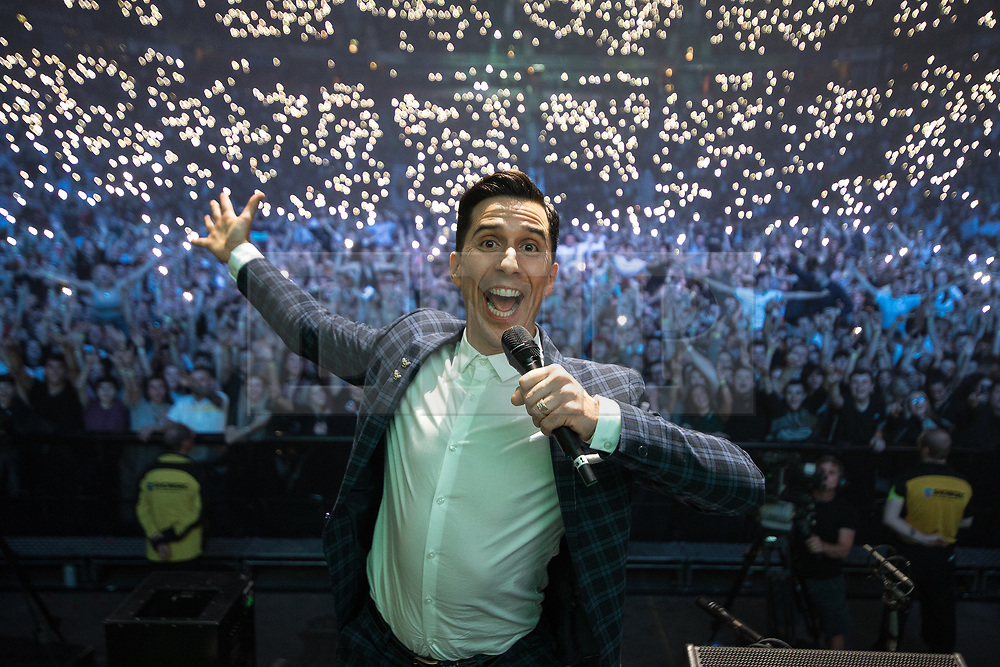 © Licensed to London News Pictures . 09/09/2017. Manchester , UK . Compere RUSSELL KANE on the stage with the crowd behind . We Are Manchester reopening charity concert at the Manchester Arena with performances by Manchester artists including  Noel Gallagher , Courteeners , Blossoms and the poet Tony Walsh . The Arena has been closed since 22nd May 2017 , after Salman Abedi's terrorist attack at an Ariana Grande concert killed 22 and injured 250 . Money raised will go towards the victims of the bombing . Photo credit: Joel Goodman/LNP