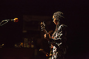 Esperanza Spalding in a quiet moment on stage in Prospect Park.
