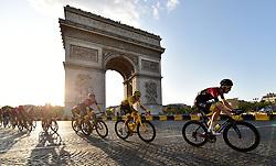 Team Deceunininck Quick Step's Julian Alaphilippe (centre) cycles past the Arc De Triomphe during stage 21 of the Tour de France during stage 21 of the Tour de France.