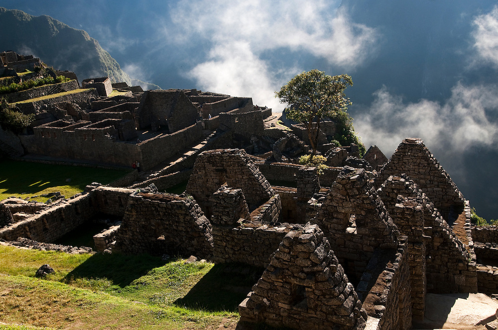 The early morning sun of the winter solstice on July 21st hits the remains of Machu Picchu in Peru.