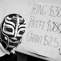 Excited young fan waits outside for the opening of the Luchador show, Mexico City, Mexico