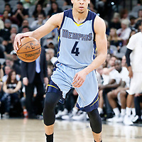04 April 2017: Memphis Grizzlies guard Wade Baldwin IV (4) brings the ball up court during the San Antonio Spurs 95-89 OT victory over the Memphis Grizzlies, at the AT&T Center, San Antonio, Texas, USA.
