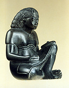 Model of a seated scribe.  18th Dynasty. Berlin Museum