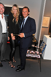 Centre & right, ELLE MACPHERSON and GERRARD FAGGIONATO at the Private View of the Pavilion of Art & Design London 2011 held in Berkeley Square, London on 10th October 2011.