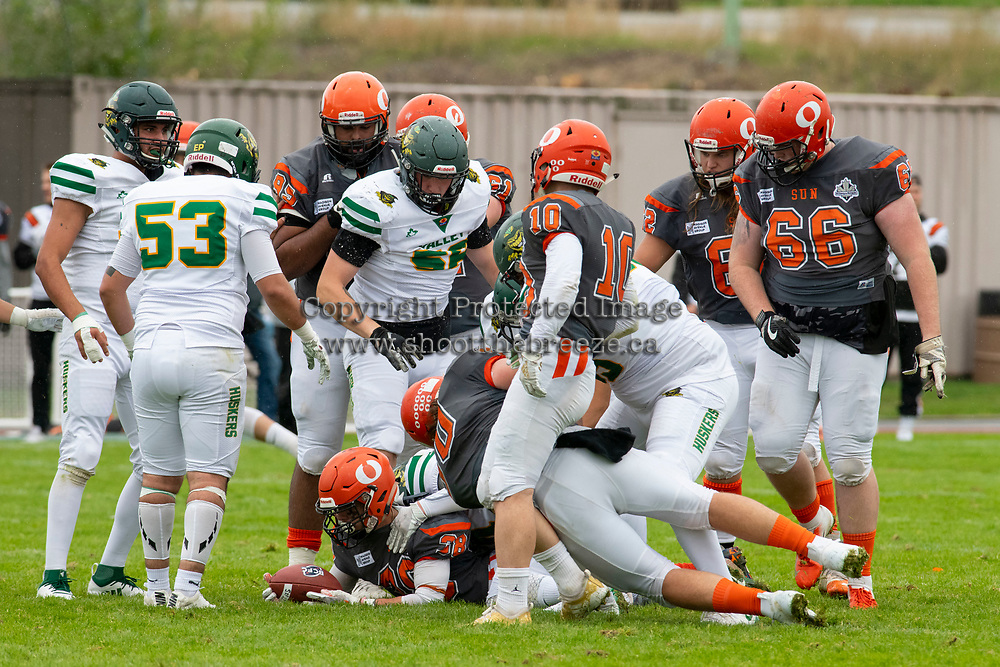 KELOWNA, BC - SEPTEMBER 22:  Kelton Kouri #38 of Okanagan Sun is tackled by the Valley Huskers at the Apple Bowl on September 22, 2019 in Kelowna, Canada. (Photo by Marissa Baecker/Shoot the Breeze)