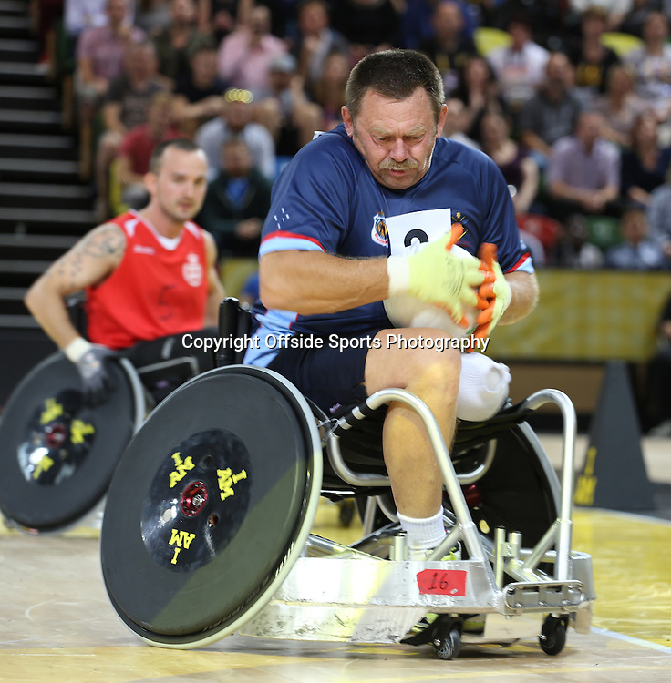 12 September 2014 - Invictus Games Day 2 - The Australian number 2 shows he is not going to let go of the ball.<br /> <br /> Photo: Ryan Smyth/Offside