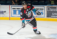 KELOWNA, CANADA - OCTOBER 18:  Madison Bowey #4 of the Kelowna Rockets warms up on the ice as the Prince George Cougars visit the Kelowna Rockets on October 18, 2012 at Prospera Place in Kelowna, British Columbia, Canada (Photo by Marissa Baecker/Shoot the Breeze) *** Local Caption ***
