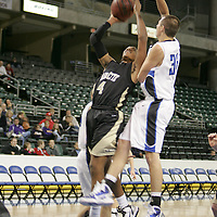 Lancer forward Aaeron Smith (4) lays up against Pioneer forward Ryan Tune (35) in an attempt to score