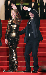 Kylie Minogue and Denis Lavant  at the premiere of their new film Holy Motors at the Cannes Film Festival, Wednesday, 23rd May 2012.  May 2012. Photo by: Stephen Lock / i-Images