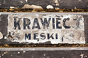 03.03.2014 Stary szyld krawca meskiego wymalowany na scianie kamienicy na ul Brzeska photo Piotr Gesicki Old men's tailor signboard on wall in Warsaw Poland photo by Piotr Gesicki