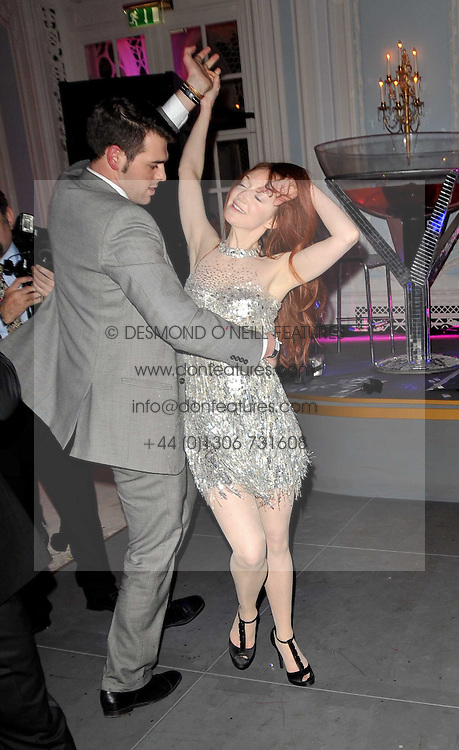 OLIVIA GRANT dancing at Quintessentially's 10th birthday party held at The Savoy Hotel, London on 13th December 2010.