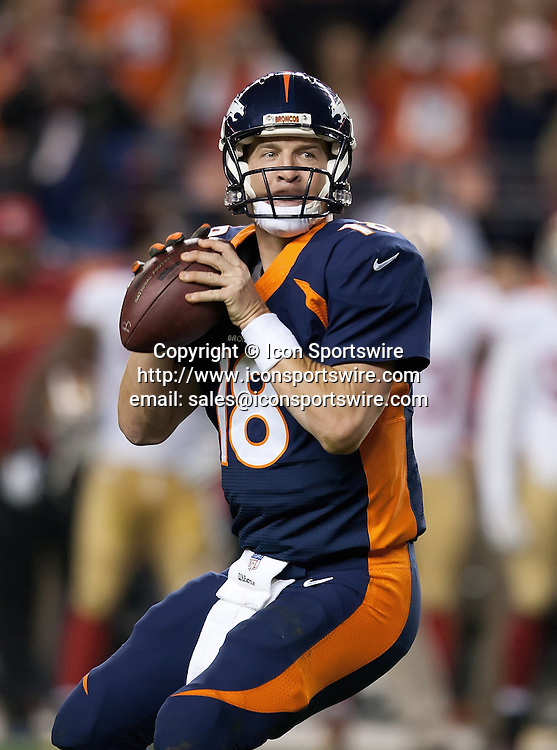 Oct. 19, 2014 - Denver, Colorado, U.S - Broncos QB PAYTON MANNING readies to throw his record #509 TD pass during the 2nd. quarter at Sports Authority Field at Mile High Sunday afternoon. The Broncos beat the 49ers 42-17