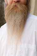 man with large pointed beard