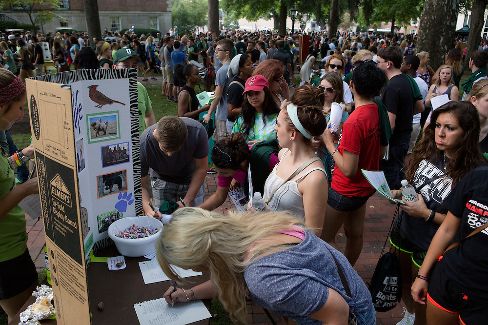 Incoming freshmen sign up for the Ohio University Wildlife Club and other student organizations during the Involvement Fair on the College Green on Aug. 24, 2014. Photo by Lauren Pond