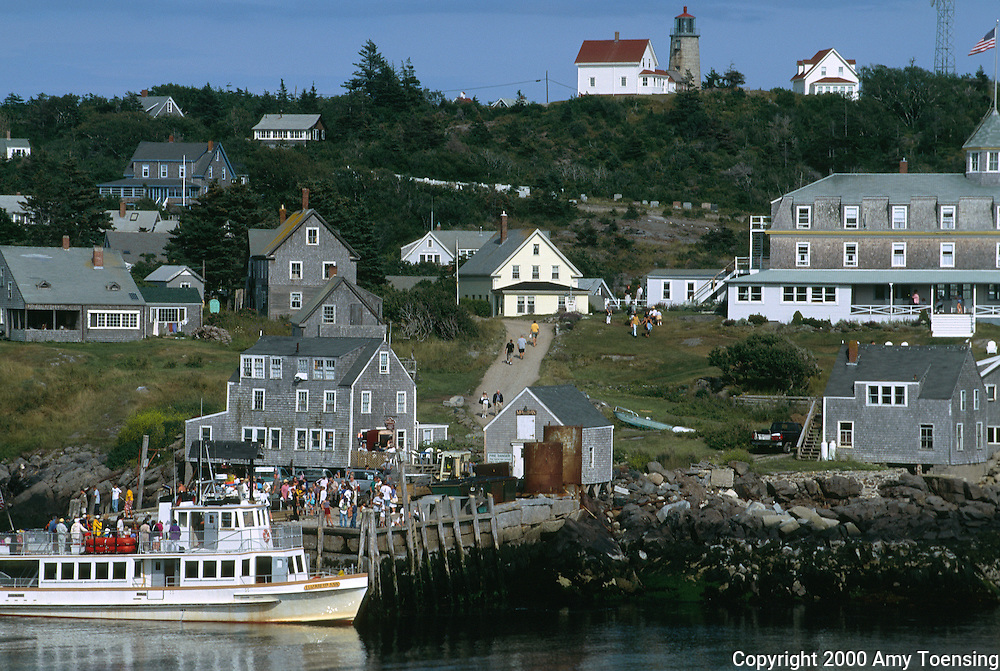 MONHEGAN ISLAND, MAINE - JULY 30: The ferry arrives with visitors July 30, 2000 on Monhegan Island, Maine. Monhegan Island, home to lobstermen and painters and a popular destination for tourists is twelve miles off the coast of Maine. Ringed by high, dark cliffs, its interior a mix of meadows, marsh and spruce groves, Monhegan is one of just 14 true island communities left off the coast of Maine. The island has a 65 permanent, year-round residents and the population grows to around 200 in the summer, with day-trippers adding several hundred more. (Photo by Amy Toensing) _________________________________________<br />