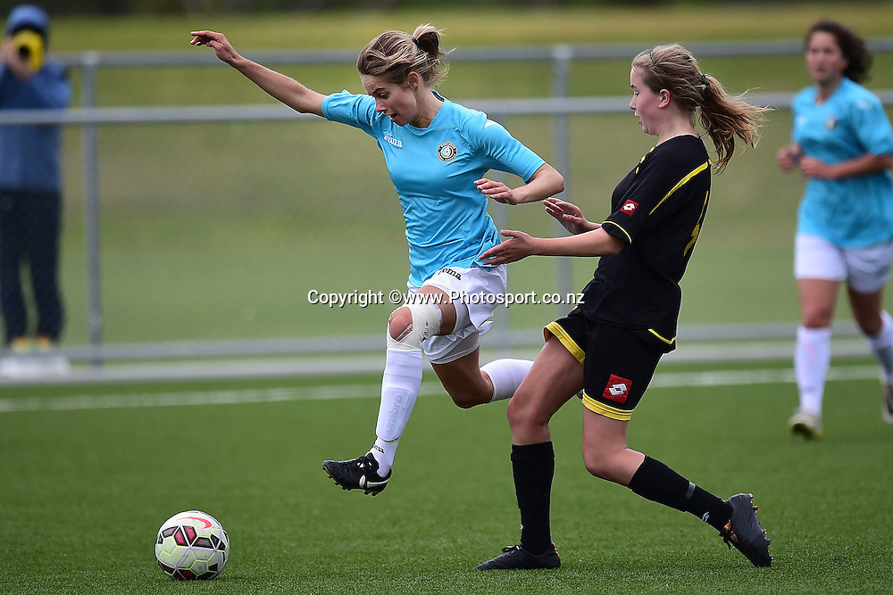 Katie Rood of Northern Football (L) is tackled by Hope Gilchrist of Capital Football during the ASB Women's League Capital v Northern football match in Petone, Wellington on Sunday the 2nd of November 2014. Photo by Marty Melville/www.Photosport.co.nz