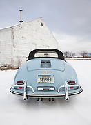 Image of a 1958 Porsche 356 Speedster in the snow in Missoula, Montana, Pacific Northwest, property released
