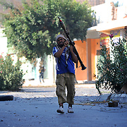 A rebel fighter prepares an attack on pro-Gaddafi men positioned in Zawiyah's main square.