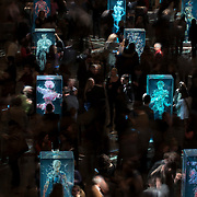 February 12, 2015 - New York, NY : Patrons of the New York City Ballet view artist Dustin Yellin's 'Psychogeographies,' a set of 15 sculptural collages/paintings in the David H. Koch Theater at Lincoln Center on Thursday evening during a party following the evening's performance. Yellin made the works for New York City Ballet's 2015 Art Series. CREDIT: Karsten Moran for The New York Times