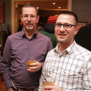 Lee Stillings, left, and Jeff Gerhart pose for a picture Sunday December 21, 2014 during the Brooklyn Arts District Christmas party at Canape in Wilmington, N.C. (Jason A. Frizzelle)