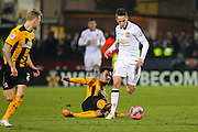 Manchester United's Adnan Janazaj avoids a tackle from Cambridge United Ryan Donaldson during the The FA Cup match between Cambridge United and Manchester United at the R Costings Abbey Stadium, Cambridge, England on 23 January 2015. Photo by Phil Duncan.