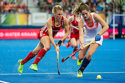 England's Alex Danson battles with Marloes Keetels of The Netherlands. England v The Netherlands - Final Unibet EuroHockey Championships, Lee Valley Hockey & Tennis Centre, London, UK on 30 August 2015. Photo: Simon Parker