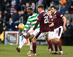 Celtic's Moussa Dembele tries to get past Hearts Ross Callachan and Connor Randall during the Ladbrokes Scottish Premiership match at Tynecastle Stadium, Edinburgh.