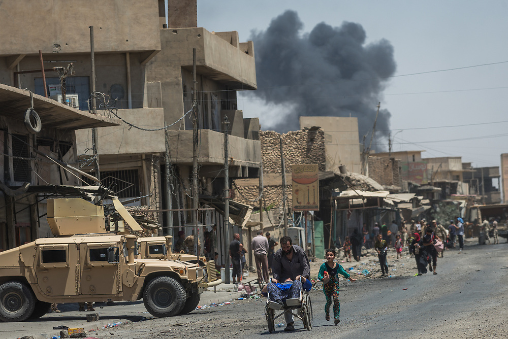 Civilians flee as the fighting continues to retake the remaining pocket of ISIS-held territory in the Old City of Mosul, Iraq, on June 21, 2017. <br /> <br /> As Iraqi forces pushed into the Old City routes were opened for civilians to escape.