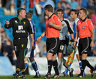 Picture by Ady Kerry/Focus Images Ltd.  .26/09/09.Norwich manager Paul Lambert talks with referee Paul taylor at the end of the game following their Coca-Cola League 1 game at the Priestfield Stadium, Gillingham, Ken