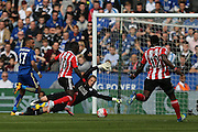 Leicester City goalkeeper Kasper Schmeichel (1)  tries to save from Southampton midfielder Sadio Mane (10)  during the Barclays Premier League match between Leicester City and Southampton at the King Power Stadium, Leicester, England on 3 April 2016. Photo by Simon Davies.