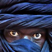 I made this picture of a young Tuareg my first day in Timbuktu, Mali. This ancient desert outpost sits on the edge of the Sahara Desert, 15 kilometres north of the main channel of the Niger River. It became a permanent settlement in the 12th Century and established itself as a prominent commercial and educational center, at one point hosting over 200 schools. I was flown to Mali with the Canadian Red Cross to document extensive malarial programs that included the distribution of 1.8 million nets to Malian families. After the contract was completed I headed north to the land of the Tuaregs.