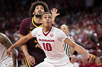 FAYETTEVILLE, AR - DECEMBER 9:  Daniel Gafford #10 of the Arkansas Razorbacks blocks out Jordan Murphy #3 of the Minnesota Golden Gophers at Bud Walton Arena on December 9, 2017 in Fayetteville, Arkansas.  The Razorbacks defeated the Golden Gophers 95-79.  (Photo by Wesley Hitt/Getty Images) *** Local Caption *** Daniel Gafford; Jordan Murphy