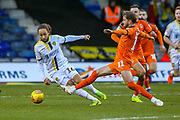 Luton Town midfielder Andrew Shinnie (11) tackles Burton Albion midfielder Marcus Myers-Harness (16) during the EFL Sky Bet League 1 match between Luton Town and Burton Albion at Kenilworth Road, Luton, England on 22 December 2018.