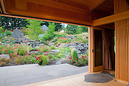 View through and from inside the yoga pavilion looking out onto the gardens and water feature