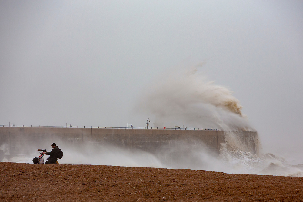 A photographer checks files of waves cresting over Folkstone Harbour Arm, Folkestone, Kent on the south coast of England,  Sunday February 9, 2020, as Storm Ciara swept over the United Kingdom. Amber weather warnings were put into place by the MET office as gusts of up to 90mph and heavy rain swept across the UK. An amber warning from the MET office expects a powerful storm that will disrupt air, rail and sea links travel, cancel sports events, cut electrical power and damage property.  (photo by Andrew Aitchison / In pictures via Getty Images)