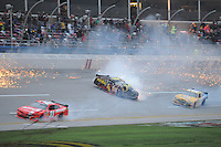 May 4, 2013; Talladega, AL, USA; NASCAR Nationwide Series driver Elliott Sadler (11) and Landon Cassill (4) and  Alex Bowman (99) crash on the final lap of the Aaron's 312 at Talladega Superspeedway. Regan Smith won the race. Mandatory Credit: Randy Sartin-USA TODAY Sports