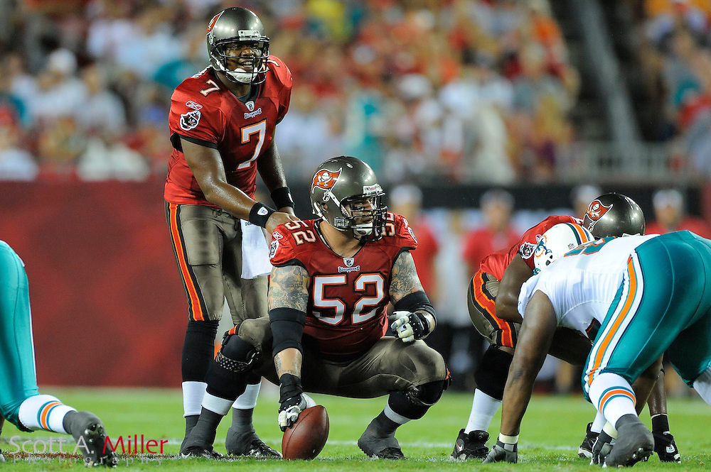Aug. 27, 2009; Tampa, FL, USA; Tampa Bay Buccaneers quarterback Byron Leftwich (7) and center Jeff Faine (52)during the first half of the Bucs game against the Miami Dolphins at Raymond James Stadium. Mandatory Credit: Scott A. Miller-US PRESSWIRE.© 2009 Scott A. Miller.© 2009 Scott A. Miller