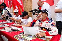 20100527: LOULE, ALGARVE, PORTUGAL - Portugal WRC Rally 2010 - Drivers signing autographs. In picture: Dani Sordo (SPA) smilling next to Kimi Raikkonen (FIN) and Sebastien Loeb (FRA). PHOTO: CITYFILES