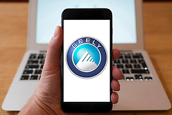 Using iPhone smartphone to display logo of Geely, Chinese car manufacturing company