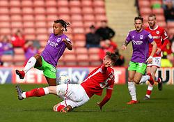 Bobby Reid of Bristol City is tackled by Liam Lindsay of Barnsley - Mandatory by-line: Robbie Stephenson/JMP - 30/03/2018 - FOOTBALL - Oakwell Stadium - Barnsley, England - Barnsley v Bristol City - Sky Bet Championship