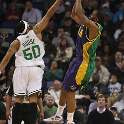 Feb 10, 2010; New Orleans, LA, USA; New Orleans Hornets guard Marcus Thornton (5) shoots over Boston Celtics guard Eddie House (50) during the first half at the New Orleans Arena. Mandatory Credit: Derick E. Hingle-US PRESSWIRE