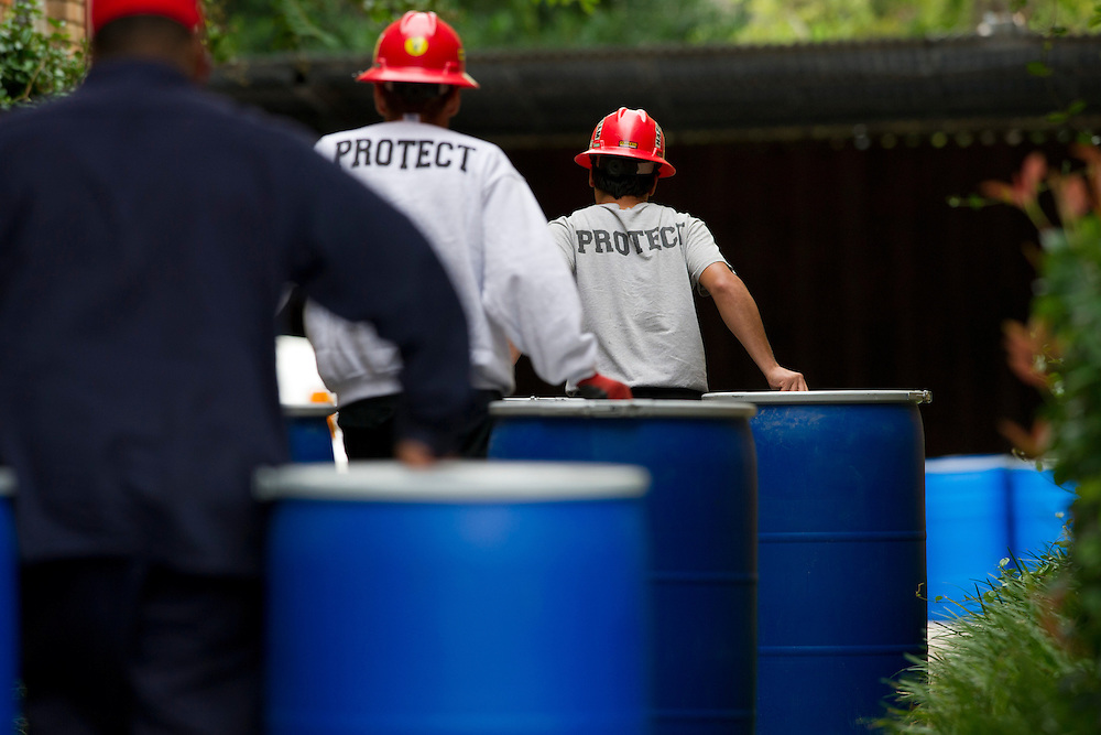 A haz-mat crew unloads barrels outside the apartment where a second Ebola patient has been reported in Dallas, Texas on October 13, 2014. (Cooper Neill for The New York Times)