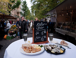 table with shrimps and fresh oysters at weekend street market on Kollwitzplatz in bohemian Prenzlauer Berg in Berlin