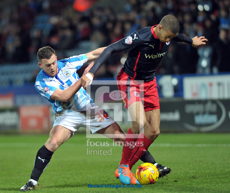 Harry Bunn of Huddersfield Town (left) battles with Michael Hector of Reading during the Sky Bet Championship match at the John Smiths Stadium, Huddersfield<br /> Picture by Graham Crowther/Focus Images Ltd +44 7763 140036<br /> 03/01/2015